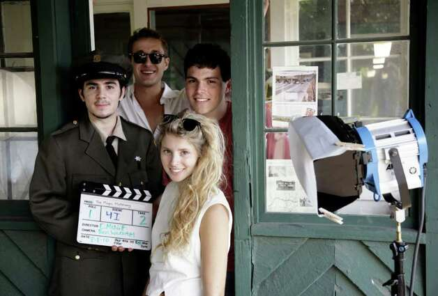 "The crew for ""The Magic Motorway"" gathers at an old toll booth on the Merritt Parkway. Clockwise from front are Director Eliza McNitt, Grant Rosenmeyer as the toll booth operator, actor Ben Wachtel and Charlie Greene, producer. Photo: Contributed Photo / Greenwich Citizen"