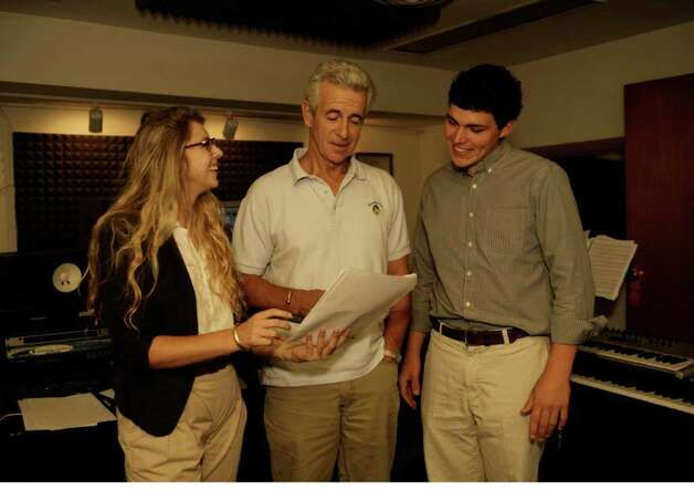 "Director Eliza McNitt and producer Charlie Greene consult with James Naughton as he readies to read his part for the film ""The Magic Motorway."" Photo: Contributed Photo / Greenwich Citizen"
