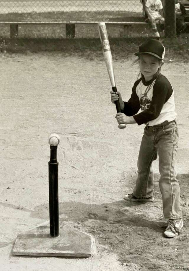 In this file photo, Dawn Thompson poses before one of her t-ball games back in the day. Finding a love for sports at a young age, Thompson, the Big Rapids High School Athletic Director, also serves as the high schools' varsity softball team coach. (Courtesy photo)