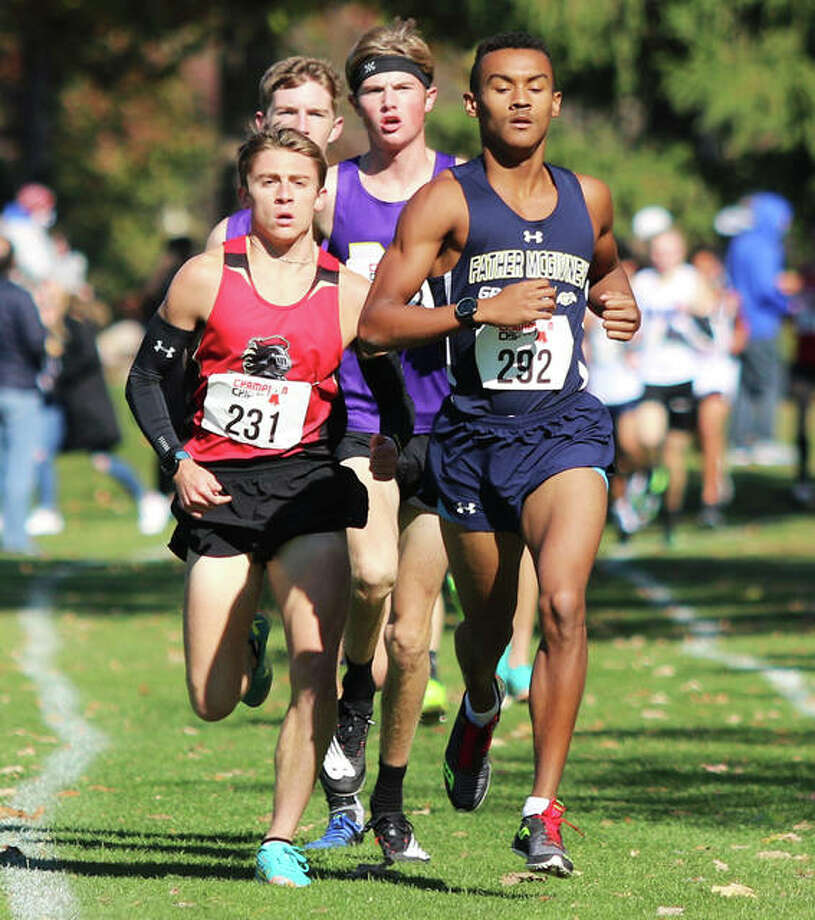 Father McGivney's Tyler Guthrie (right) and Arthur's Layton Hall (left) lead a pair of Monticello runners on the front end in the opening mile of the Decatur St. Teresa Class 1A Sectional boys cross country meet Saturday at Hickory Point golf course in Forsyth. Hall won the race, with Guthrie placing second Photo: Greg Shashack / The Telegraph