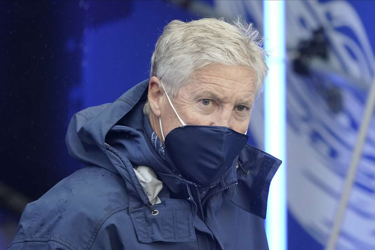 Seattle Seahawks head coach Pete Carroll walks on to the field before an NFL football game against the Minnesota Vikings, Sunday, Oct. 11, 2020, in Seattle. (AP Photo/Ted S. Warren)