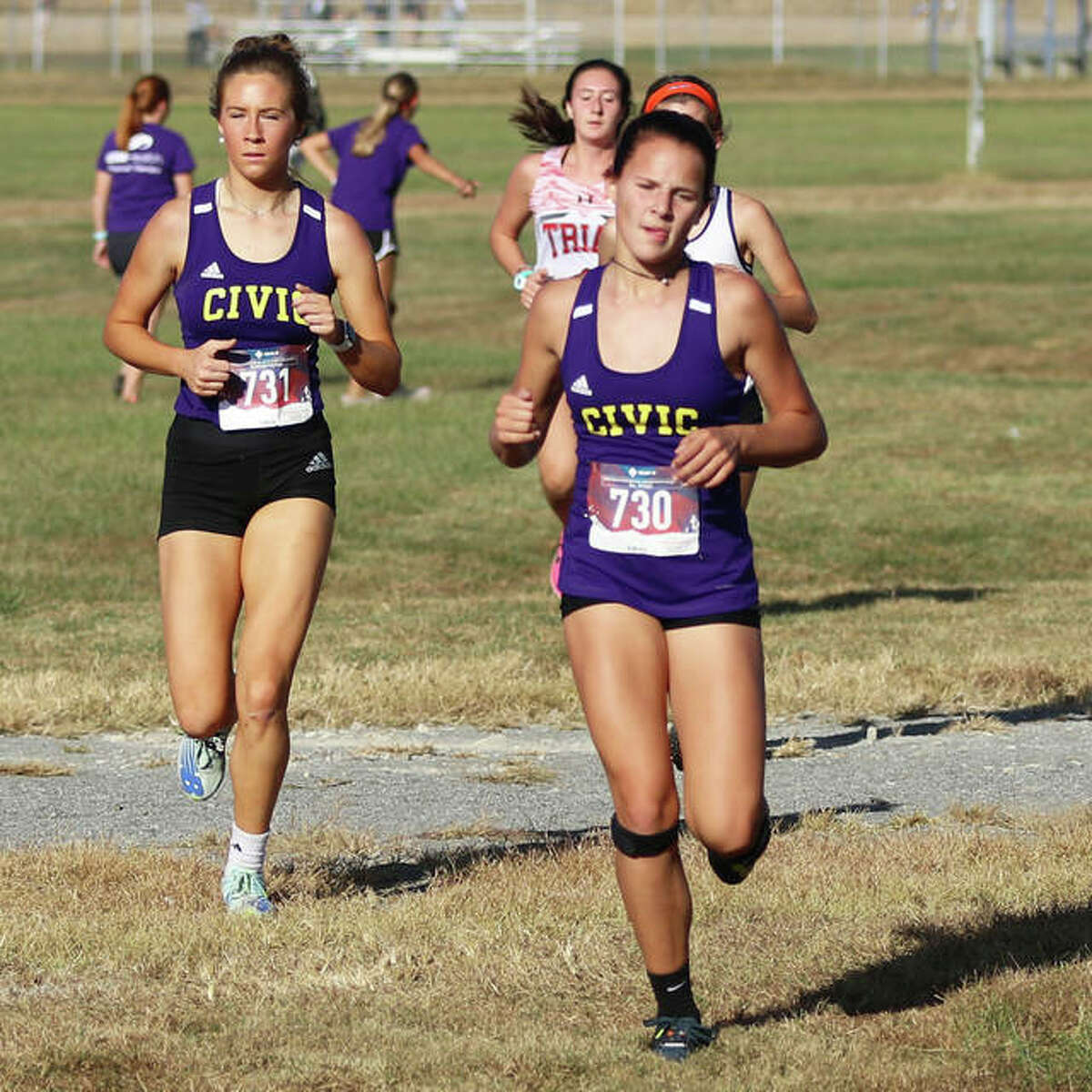 CM's Avari Combes (right) and Kate Hallstead (left) run during the MVC Meet on Oct. 13 in Mascoutah. Those two Eagles made their sectional debut Saturday at Olney.