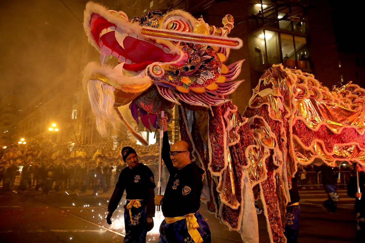 Members of the San Francisco Police Department Lion Dance Team carry a dragon during the Chinese New Year Parade in San Francisco in February. Next year's parade has been canceled because of the coronavirus pandemic.