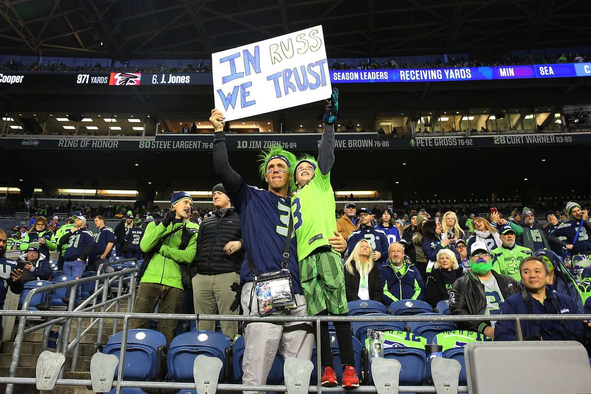 Fans hold up a sign for Russell Wilson before Seattle's game against Minnesota, Monday, Dec. 2, 2019 at CenturyLink Field. (Genna Martin, Seattlepi.com)