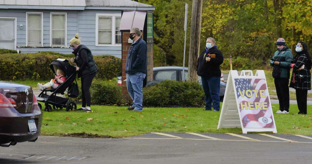 Voters wait in line outside the Guilderland Fire Department to cast their ballots in the final day of early voting on Sunday, Nov. 1, 2020, in Guilderland, N.Y. (Paul Buckowski/Times Union)