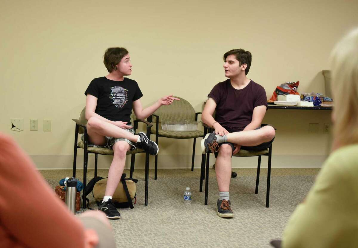 Damian Daher, left, 20, and Jake Pavia, 22, chat during the Kids in Crisis Lighthouse LBGTQ+ meeting at the Tully Health Center in Stamford, Conn. Thursday, Sept. 12, 2019.