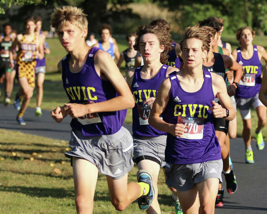 CM's (from left) Justice Eldridge, Aslan Henderson and Jackson Collman run together at the front of a pack of runners in the Madison County Small-Schools boys cross country meet Oct. 6 at Belk Park in Wood River. The Eagles ended their season Saturday at the Olney Class 2A Sectional. Photo: Greg Shashack / The Telegraph