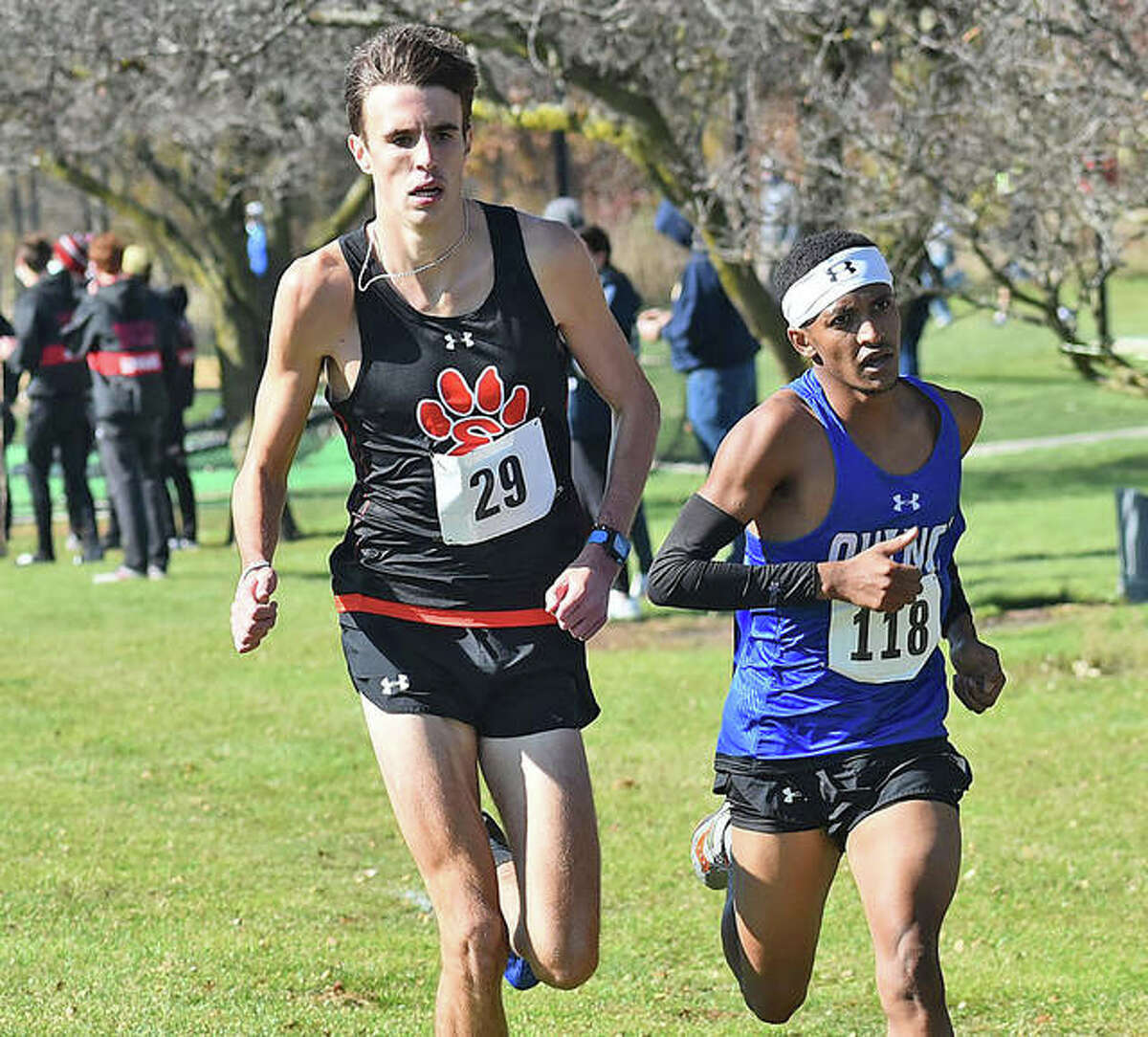 Edwardsville's 6-foot-5 junior Ryan Watts (left) and Quincy's 5-6 junior Fiker Rosen run together during the Normal Class 3A Sectional on Saturday at Maxwell Park in Normal. Watts won the race, with Rosen in second.