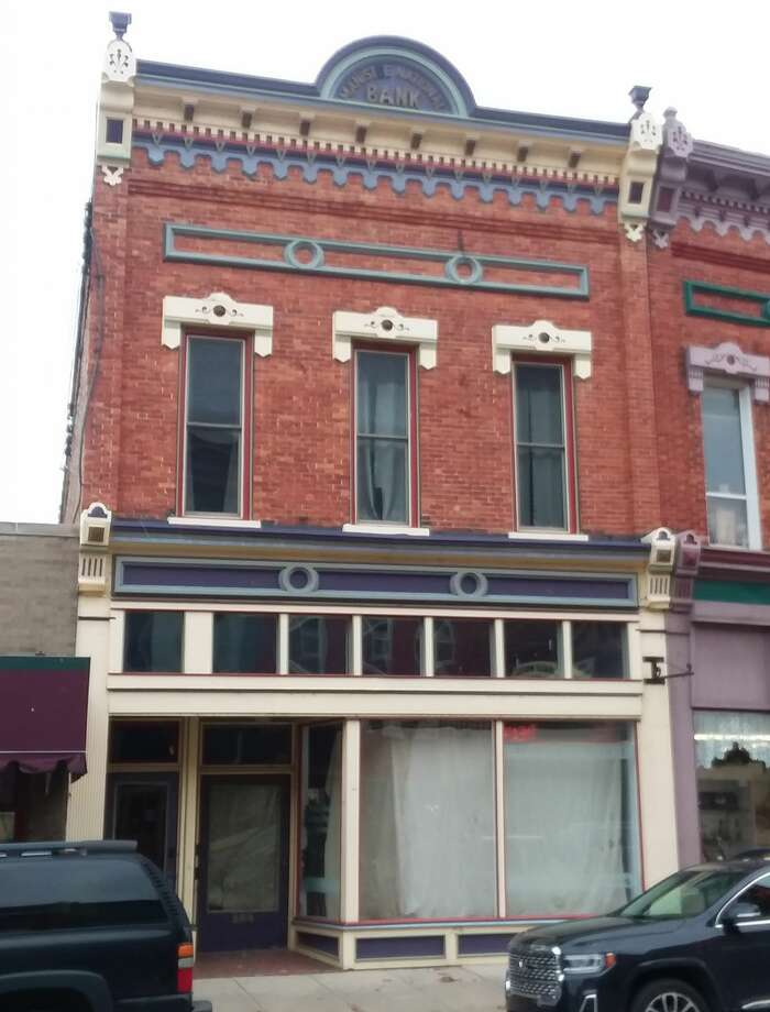 The building at 386 River St. was once home to two financial institutions, the Manistee National Bank (note the decorative piece at the very top of the building) and the Sands and Burr Bank which operated from 1902 to 1925. Photo: Manistee County Historical Museum