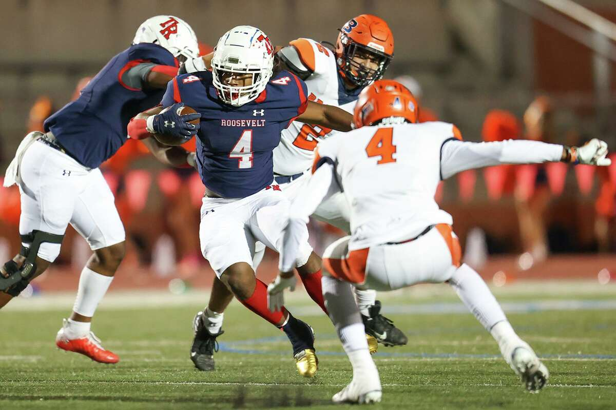Roosevelt's Reggie Hodge tries to cut upfield past Brandeis' Jalen Rainey, right, during the first half of their District 28-6A high school football game at Heroes Stadium on Saturday, Oct. 31, 2020.