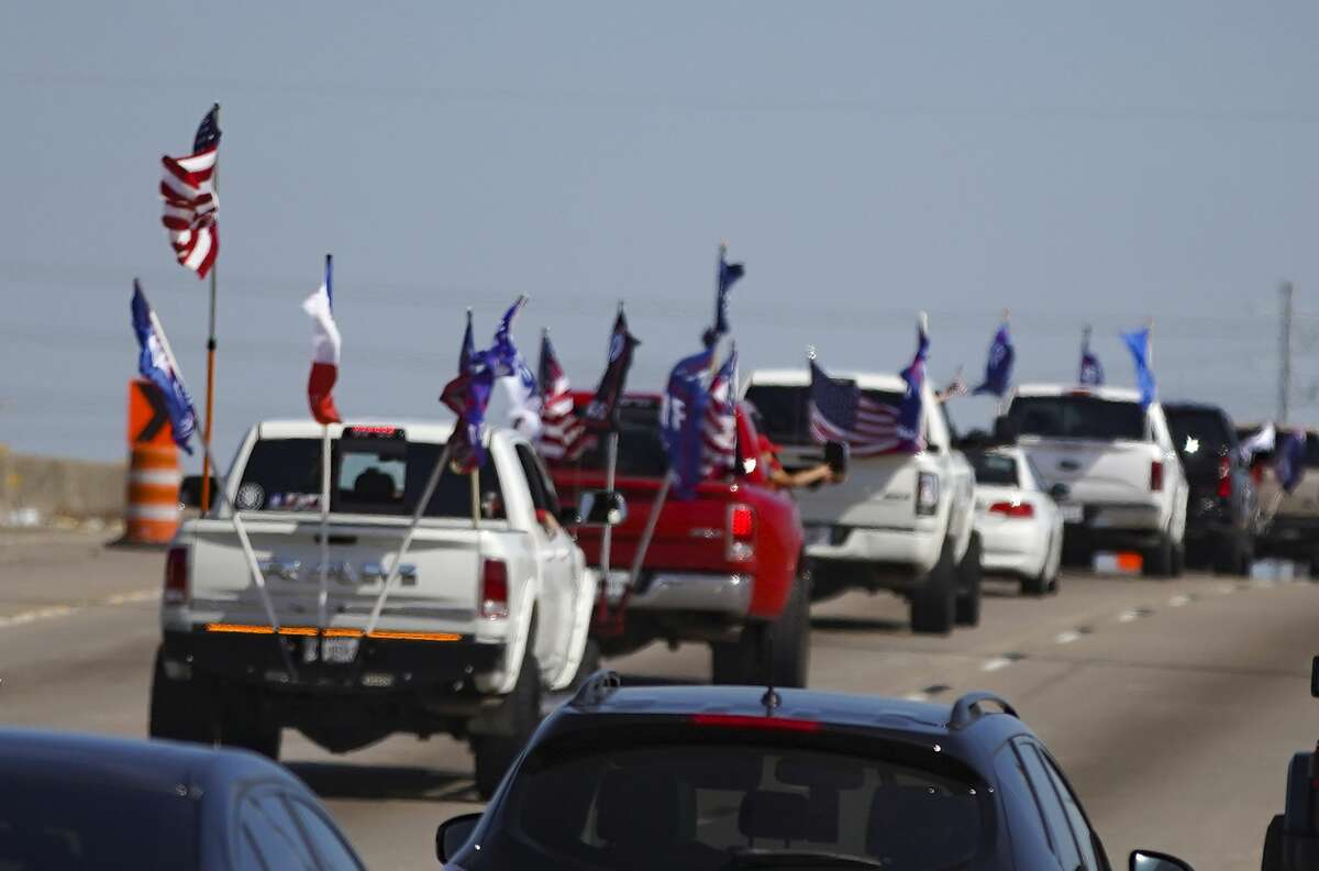 Trump supporters make their way on 610 in Houston on Sunday, Nov. 1, 2020.