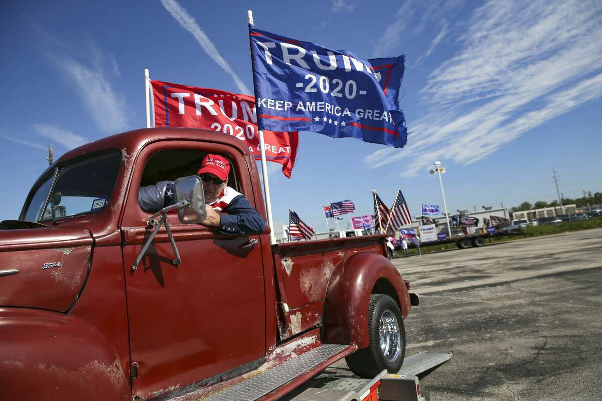 Mike Howell of Coolige, Texas, puts his 1942 Ford F-1 truck back on a trailer after participating in a Trump support rally around the 610 loop in Houston on Sunday, Nov. 1, 2020.