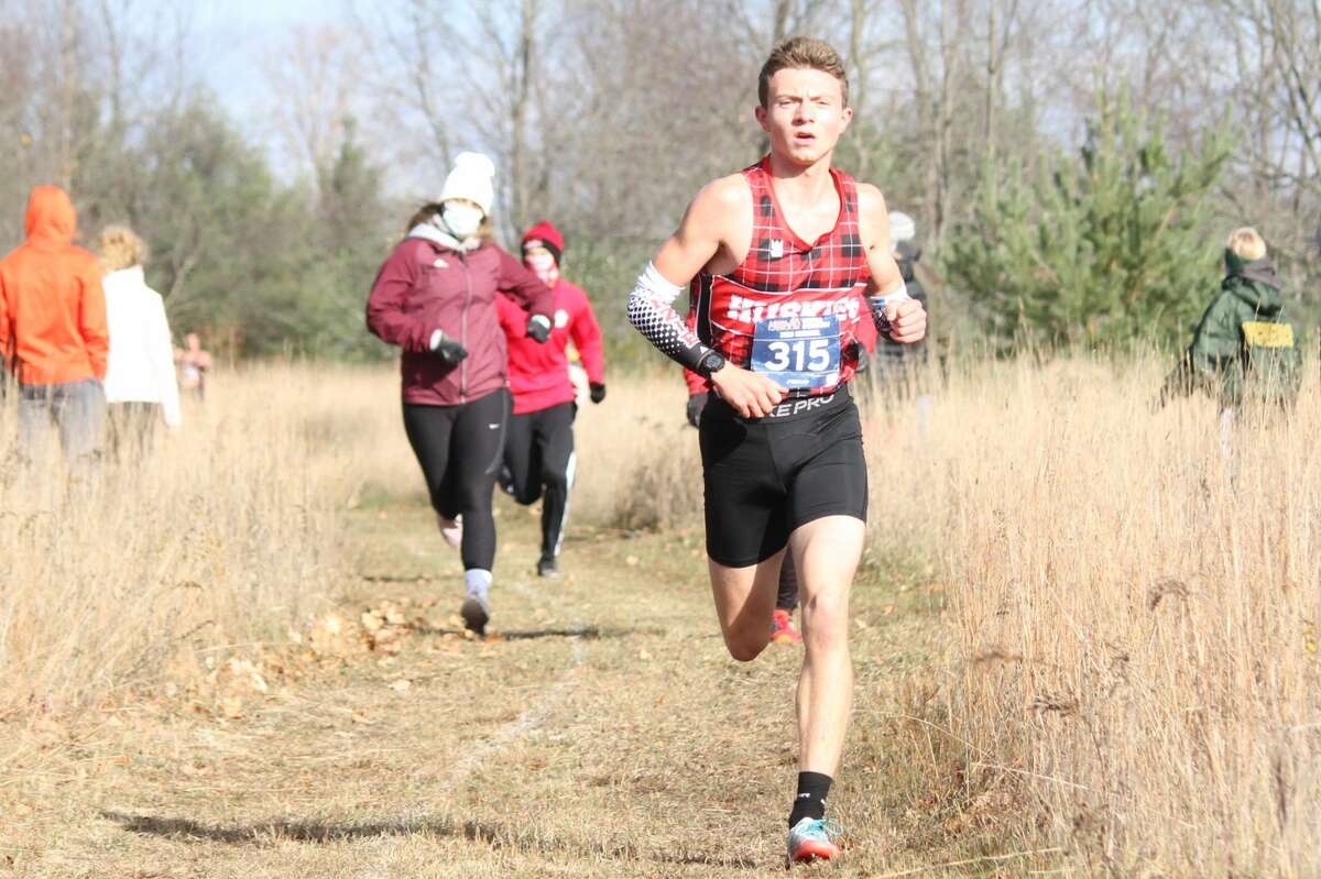 Benzie Central runners race at the regional cross country meet on Oct. 31 at Buckley.
