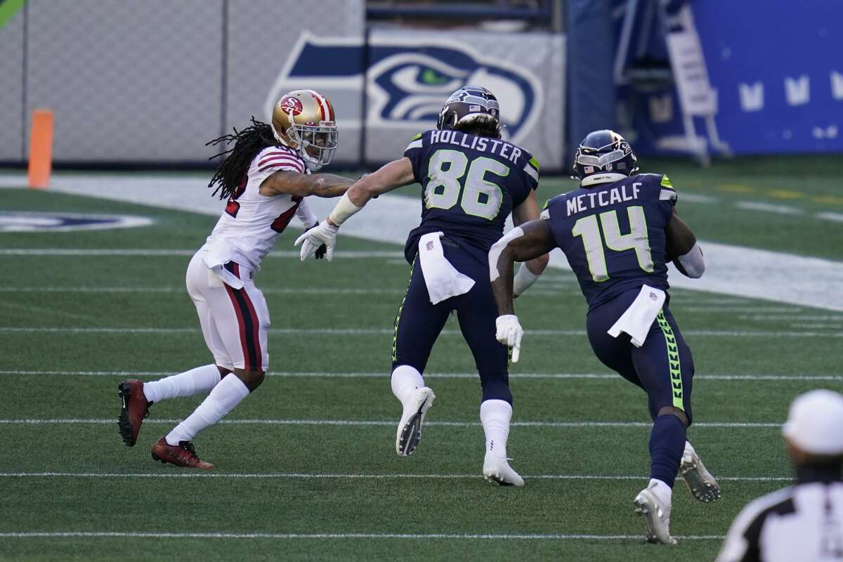 Seattle Seahawks wide receiver DK Metcalf (14) runs for a touchdown as tight end Jacob Hollister blocks after a reception against the San Francisco 49ers during the first half of an NFL football game, Sunday, Nov. 1, 2020, in Seattle. (AP Photo/Elaine Thompson)