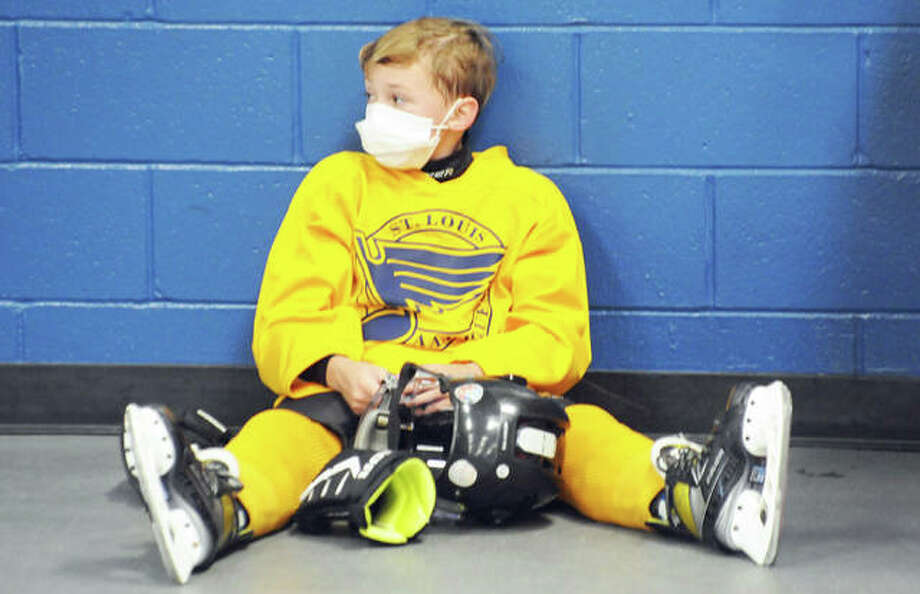 Owen Pfeffer, 10, of Edwardsville, takes a break from the open skate at East Alton Ice Arena during public skating time at the indoor facility, part of a Halloween celebration at Eastgate Plaza Saturday. Photo: David Blanchette|For The Telegraph