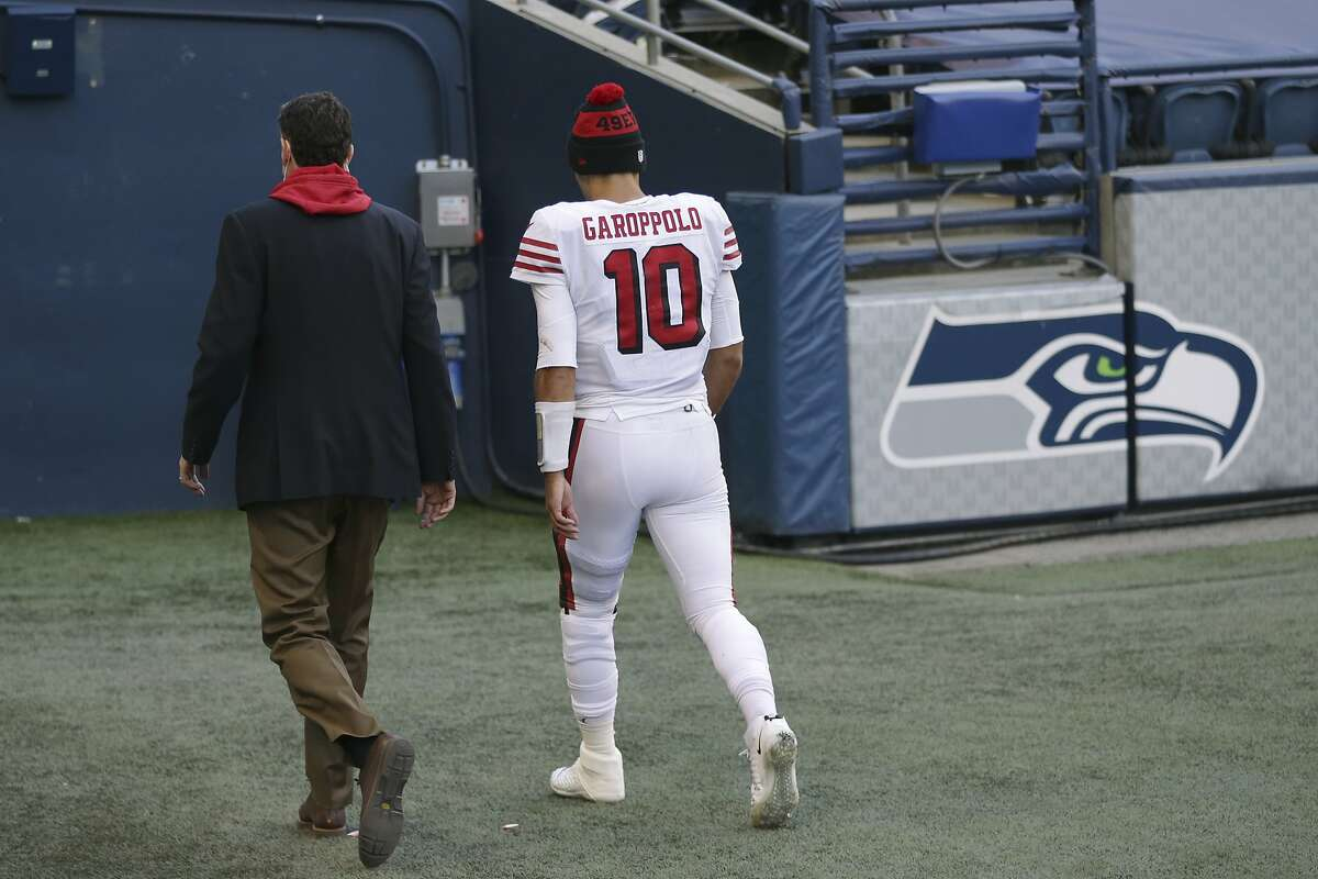 San Francisco 49ers quarterback Jimmy Garoppolo (10) walks to the locker room during the second half of an NFL football game against the Seattle Seahawks, Sunday, Nov. 1, 2020, in Seattle.