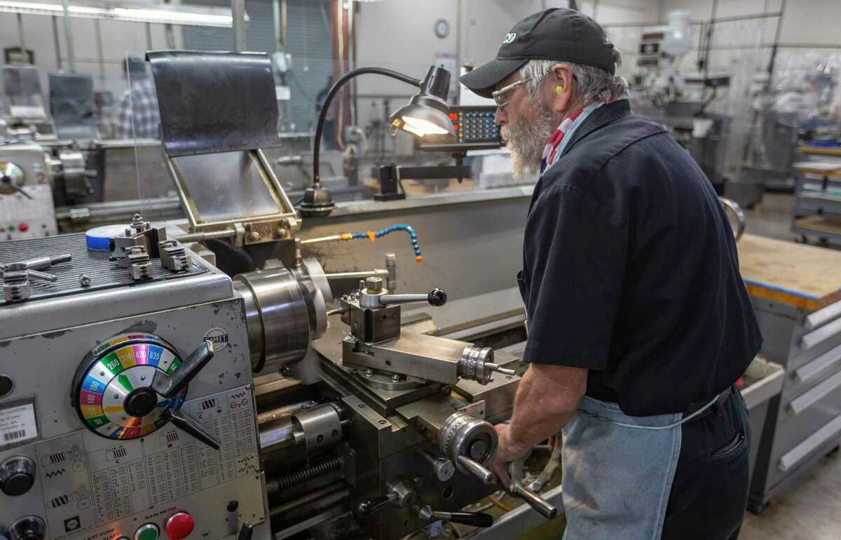 A machinist works with a lathe in Klaus Weiswurm' Innovation Technology Machinery building in Schertz Thursday, Oct. 29, 2020. In 2021, Weiswurm thinks factory automation will accelerate even faster than in recent years.