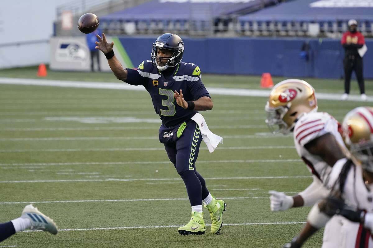 Seattle Seahawks quarterback Russell Wilson passes against the San Francisco 49ers during the second half of an NFL football game, Sunday, Nov. 1, 2020, in Seattle. (AP Photo/Elaine Thompson)