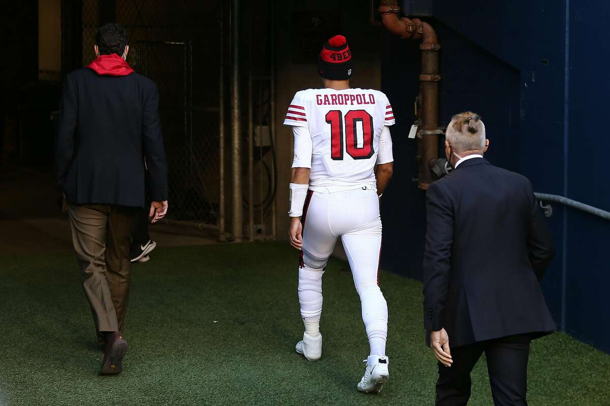 Quarterback Jimmy Garoppolo of the San Francisco 49ers exits the field as they play the at the start of the fourth quarter of the game at CenturyLink Field on Nov. 1, 2020, in Seattle.