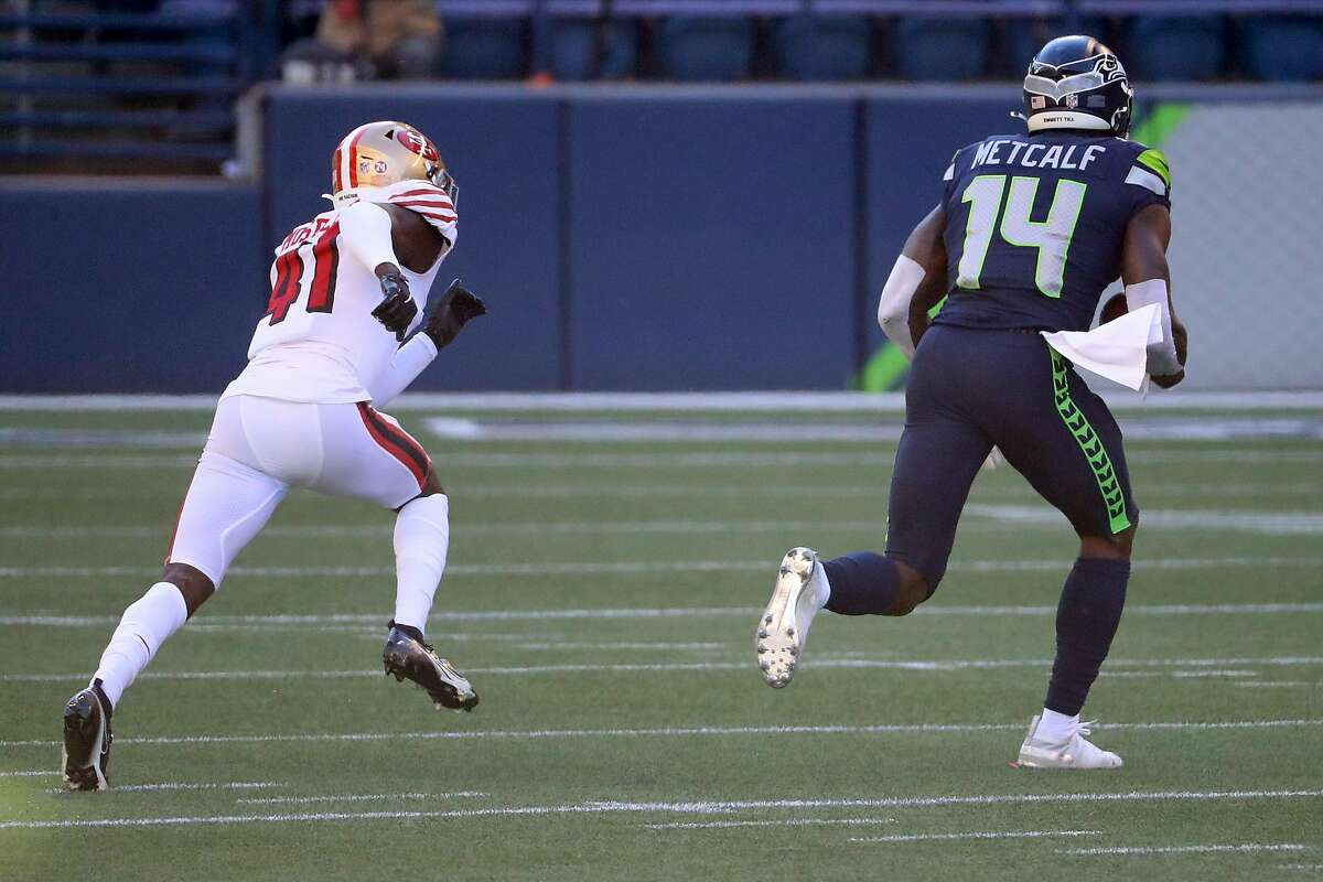 SEATTLE, WASHINGTON - NOVEMBER 01: DK Metcalf #14 of the Seattle Seahawks runs in a touchdown against Emmanuel Moseley #41 of the San Francisco 49ers in the first half of the game at CenturyLink Field on November 01, 2020 in Seattle, Washington. (Photo by Abbie Parr/Getty Images)