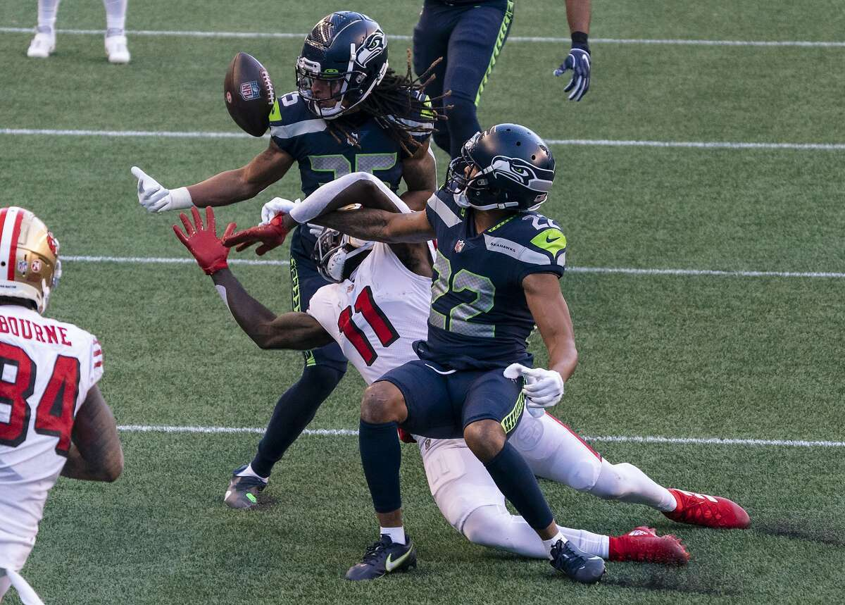 Seattle Seahawks cornerback Ryan Neal (35) and cornerback Quinton Dunbar (22) break up a pass for San Francisco 49ers wide receiver Brandon Aiyuk during the second half of an NFL football game, Sunday, Nov. 1, 2020, in Seattle. The Seahawks won 37-27. (AP Photo/Stephen Brashear)