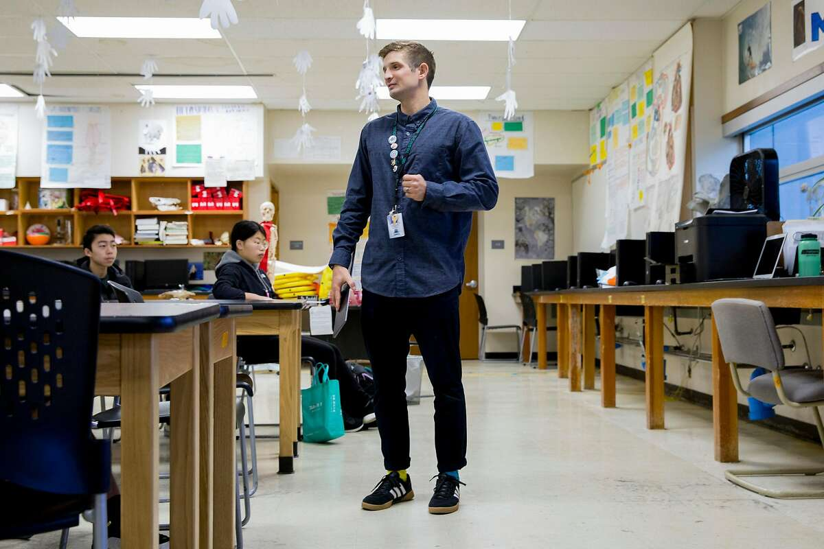 Health Science teacher Evan Mundahl works to educate his students on the coronavirus through group project work in his first period class at Phillip and Sala Burton Academic High School in San Francisco, March 11, 2020.