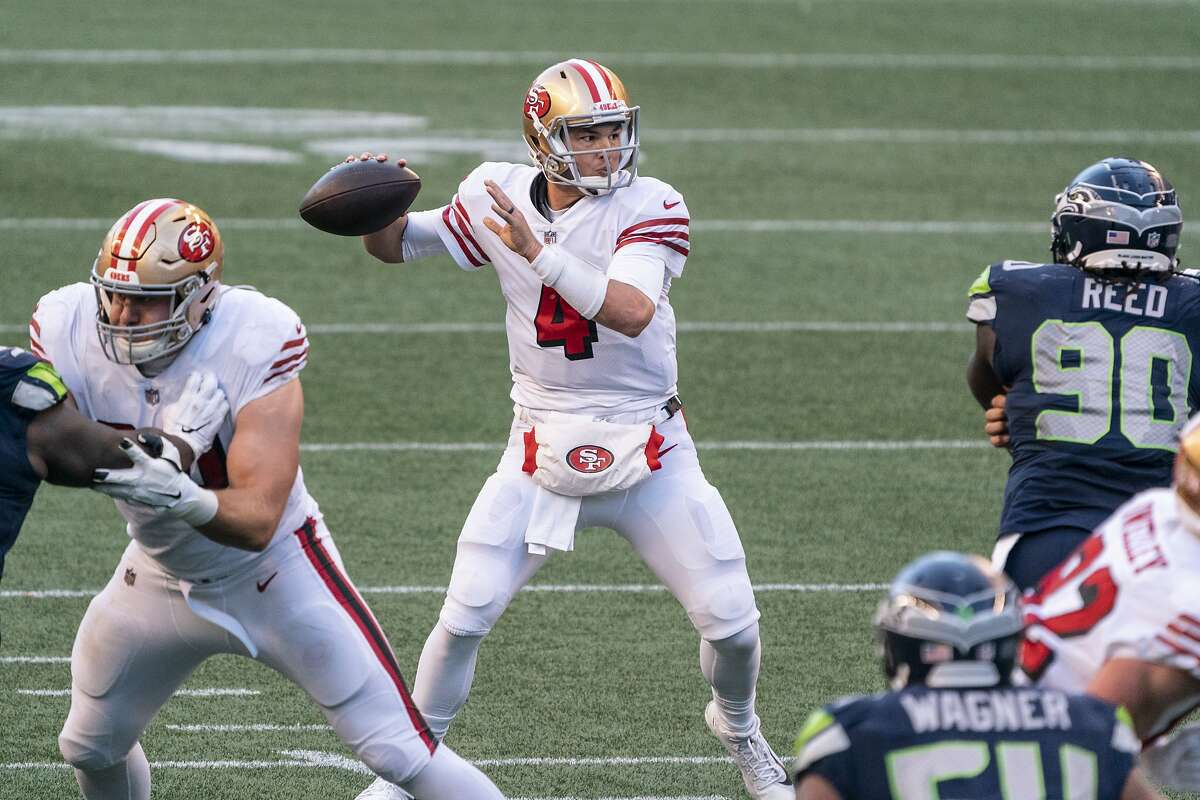 San Francisco 49ers quarterback Nick Mullens passes the ball during the second half of an NFL football game against the Seattle Seahawks, Sunday, Nov. 1, 2020, in Seattle. The Seahawks won 37-27. (AP Photo/Stephen Brashear)