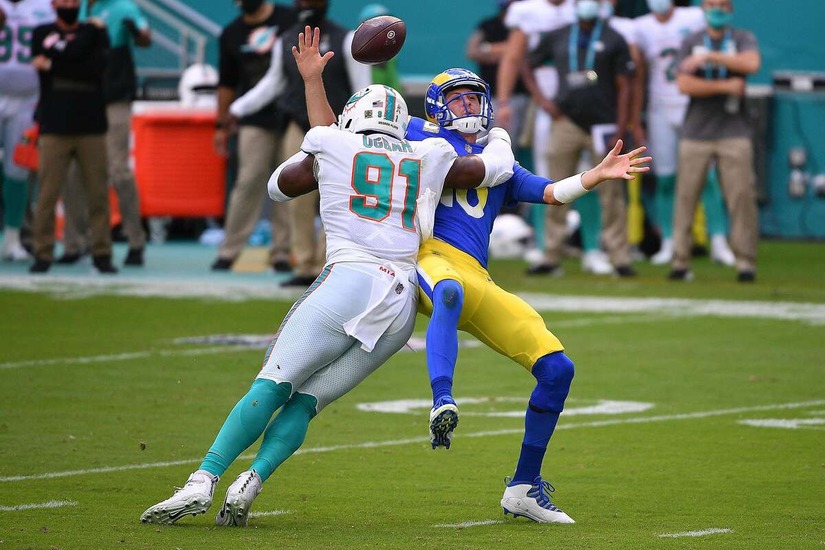 Rams QB Jared Goff fumbles on a hit from Emmanuel Ogbah during Miami's win at Hard Rock Stadium.