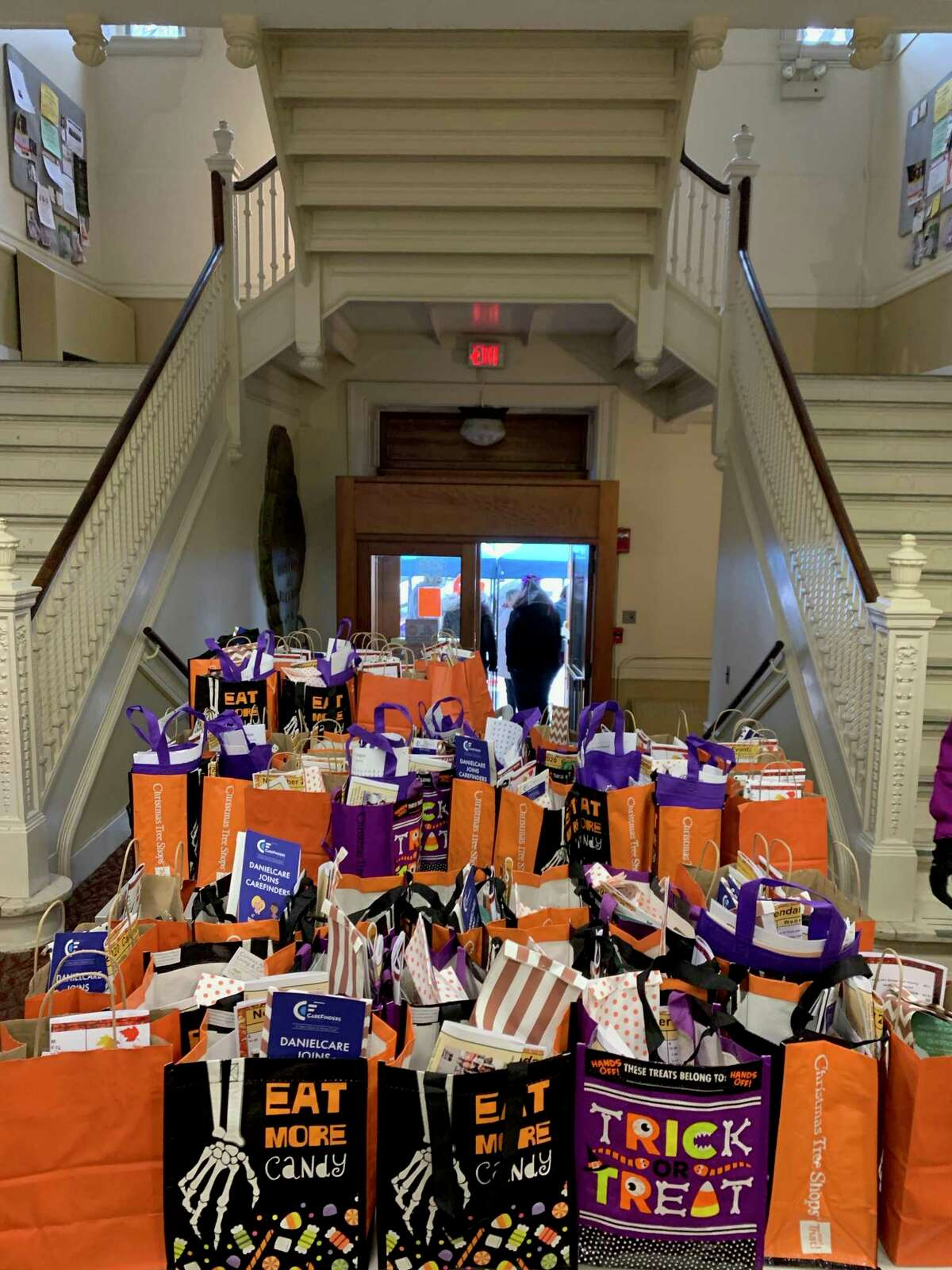 Trick-or-treat bags are distributed at the Teddy's Ready Drive-Thru Halloween Lunch for Greenwich Senior Center members on Friday, Oct. 30. Presented by the Greenwich Commission on Aging, senior center head chef Teddy Torchon and his staff served more than 150 hot lunches and distributed trick-or-treat bags full of candy and goodies from Commission on Aging sponsors. Volunteer sponsors dressed in Halloween costumes and face masks to do a contactless distribution of the bags of treats and the meals. Volunteers included Susan Doyle from Oasis Senior Advisors; Daniel Krause from DanielCare CareFinders; Officer Dan Hendrie from the Greenwich Police Department; Frank Mastrone from Residence on Summer Street; and Corinne Flax from the Bruce Museum.