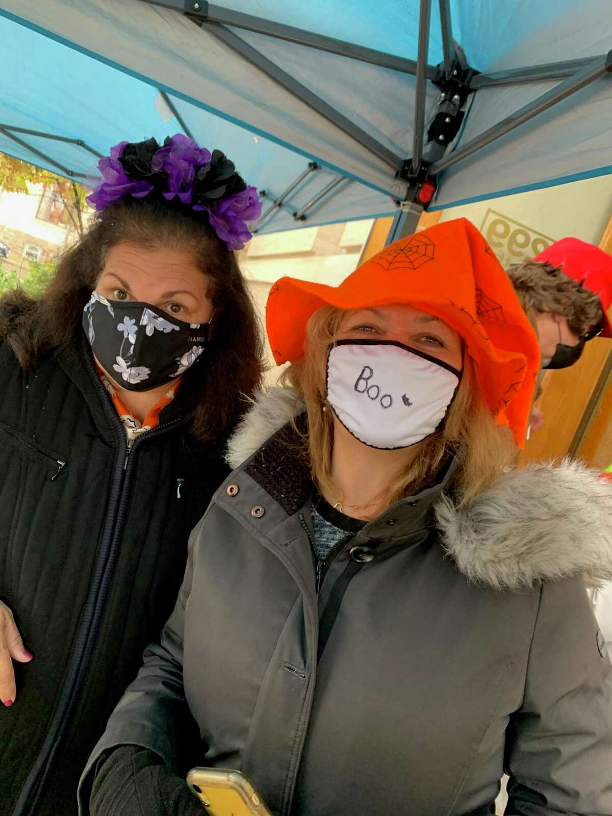 Director of the Greenwich Commission on Aging Lori Contadino, left, and Oasis Senior Adviser Susan Doyle pose during the Teddy's Ready Drive-Thru Halloween Lunch for Greenwich Senior Center members on Friday, Oct. 30. Presented by the Greenwich Commission on Aging, senior center head chef Teddy Torchon and his staff served more than 150 hot lunches and distributed trick-or-treat bags full of candy and goodies from Commission on Aging sponsors. The staff at the Senior Center said they have been helping older residents remain engaged, healthy and happy during the COVID-19 crisis. They have also been offering digital classes and events and will continue to offer Teddy's Ready Drive-Thru Lunches twice a month, throughout the year. Membership to the Senior Center is free. Members can sign up and be eligible for Drive Thru lunches for $5 per person, including a Thanksgiving feast with turkey and all the trimmings on Nov. 23. The next Drive-Thru Lunch will be Nov. 13, with glazed meatloaf with mushroom gravy, rice, peas and pearl onions, chocolate cake and refreshments. To sign up, call Deana at 203-862-6700.