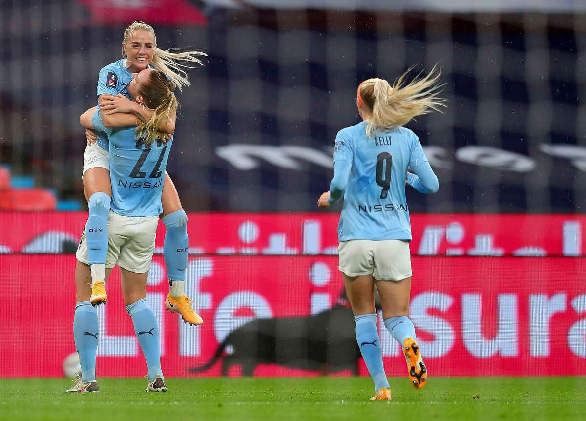 Manchester City defender Alex Greenwood jumps into the arms of Sam Mewis after the opening goal of Sunday's FA Cup final.
