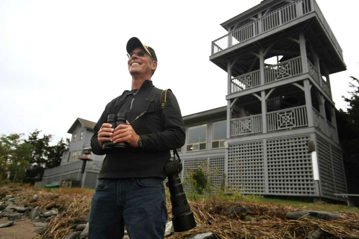 Board of Advisors member George Amato observes birds for a regular bird count at the Connecticut Audubon Coastal Center in Milford on Wednesday.