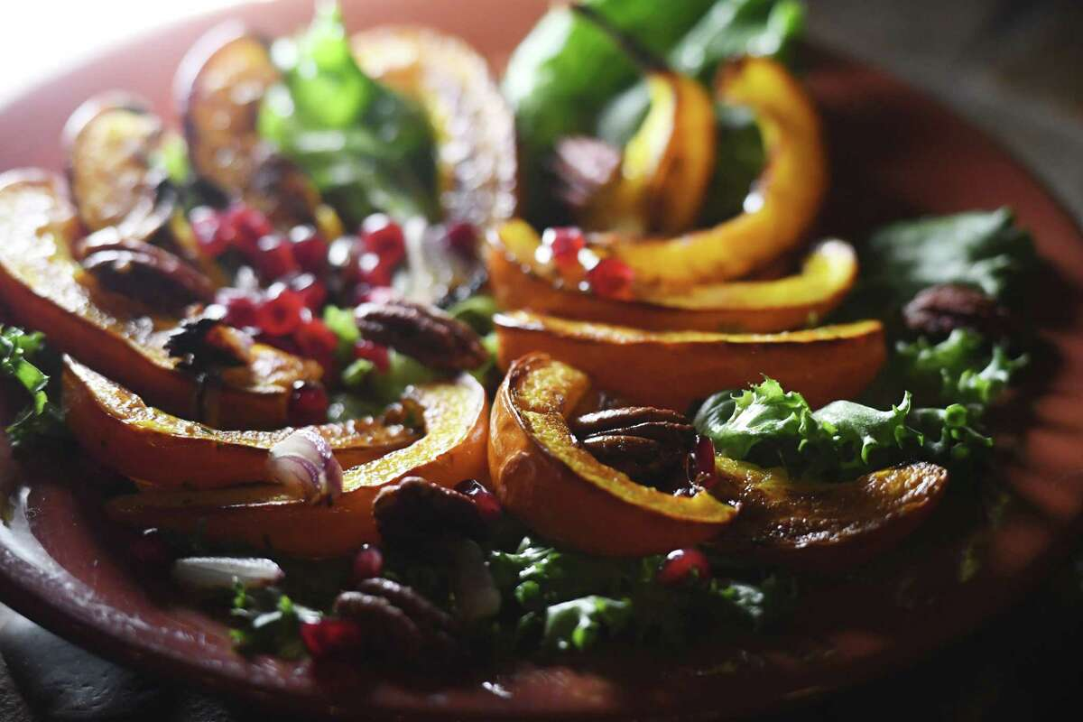 Roasted pumpkin salad with pecans and pomegranate seeds from Caroline Barrett on Wednesday, Oct. 28, 2020, at her home in Delmar, N.Y. (Will Waldron/Times Union)