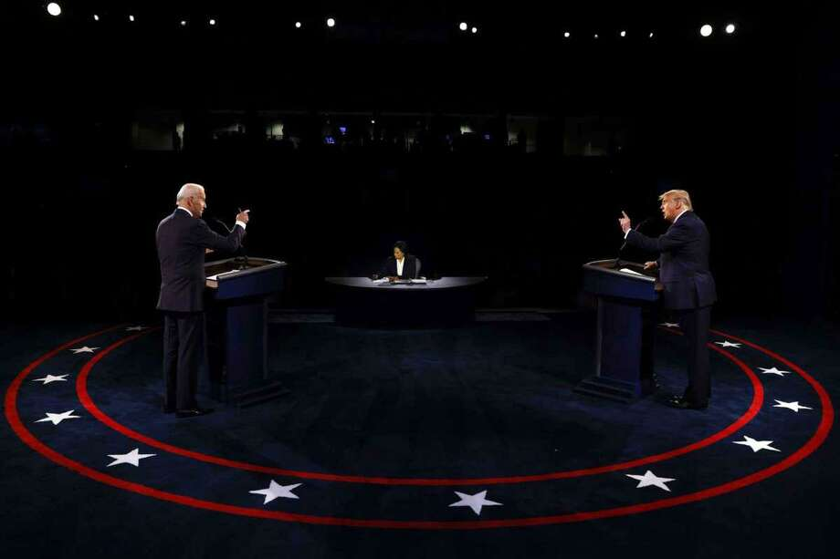 President Donald Trump and Democratic presidential candidate former Vice President Joe Biden participate in the final presidential debate at Belmont University, Thursday, Oct. 22, 2020, in Nashville, Tenn., as moderator Kristen Welker of NBC News listens. Photo: Jim Bourg /Pool Via AP