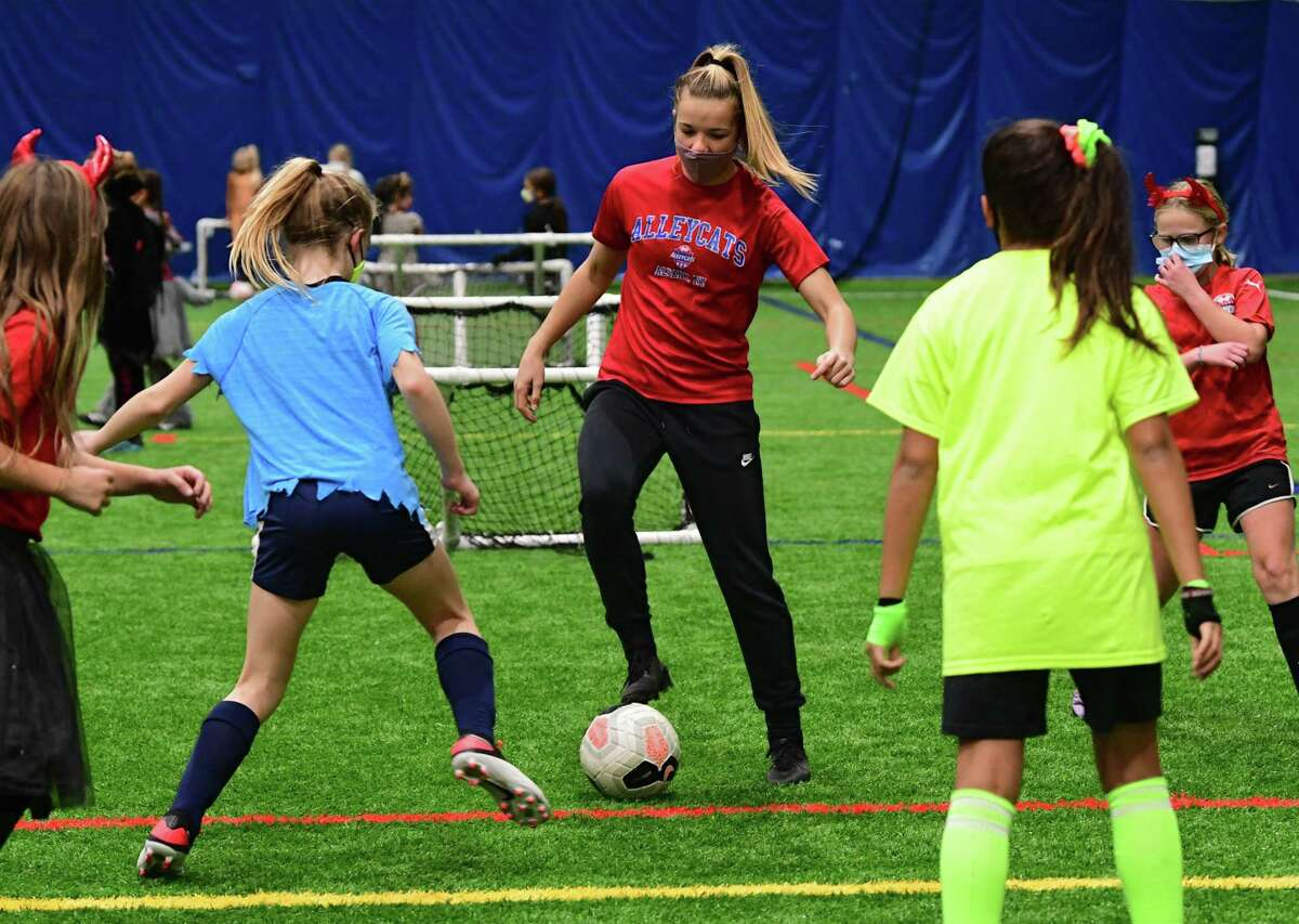 Claire Hutton, third from left, runs a drill as she coaches a girl's soccer team at Afrim's Sports Park on Thursday, Oct. 29, 2020 in Colonie, N.Y. Hutton is on the Bethlehem soccer team which is not playing this season. (Lori Van Buren/Times Union)