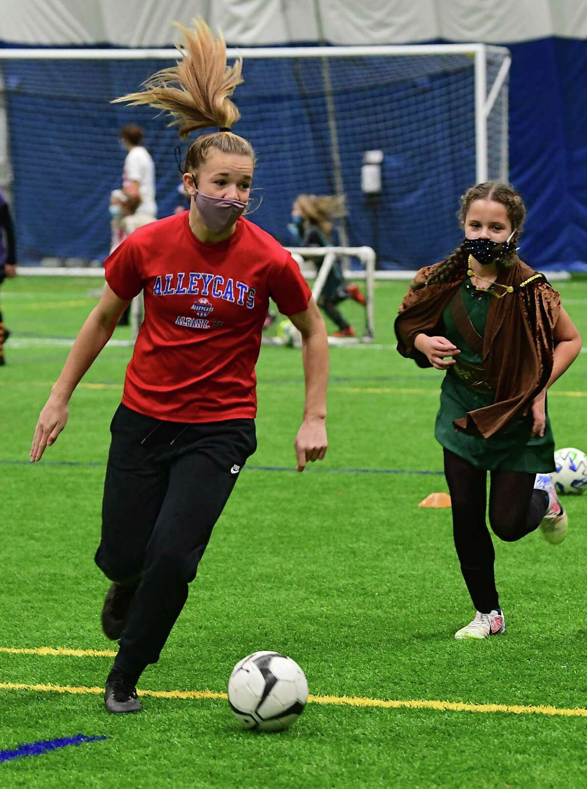 Claire Hutton, left, runs a drill as she coaches a girl's soccer team at Afrim's Sports Park on Thursday, Oct. 29, 2020 in Colonie, N.Y. Hutton is on the Bethlehem soccer team which is not playing this season. (Lori Van Buren/Times Union)