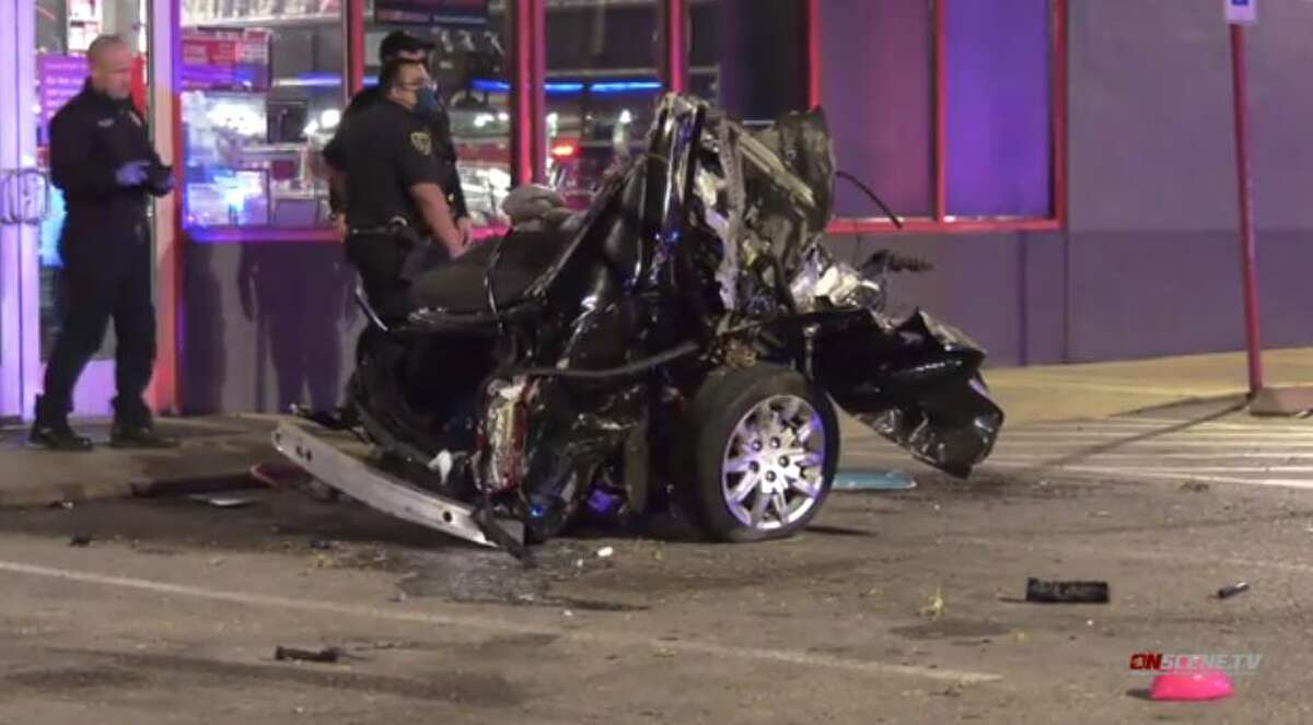 A Cadillac struck by a driver in a Mercedes police said was evading authorities was sheared in half on Westheimer in west Houston on Monday, Nov. 2, 2020.