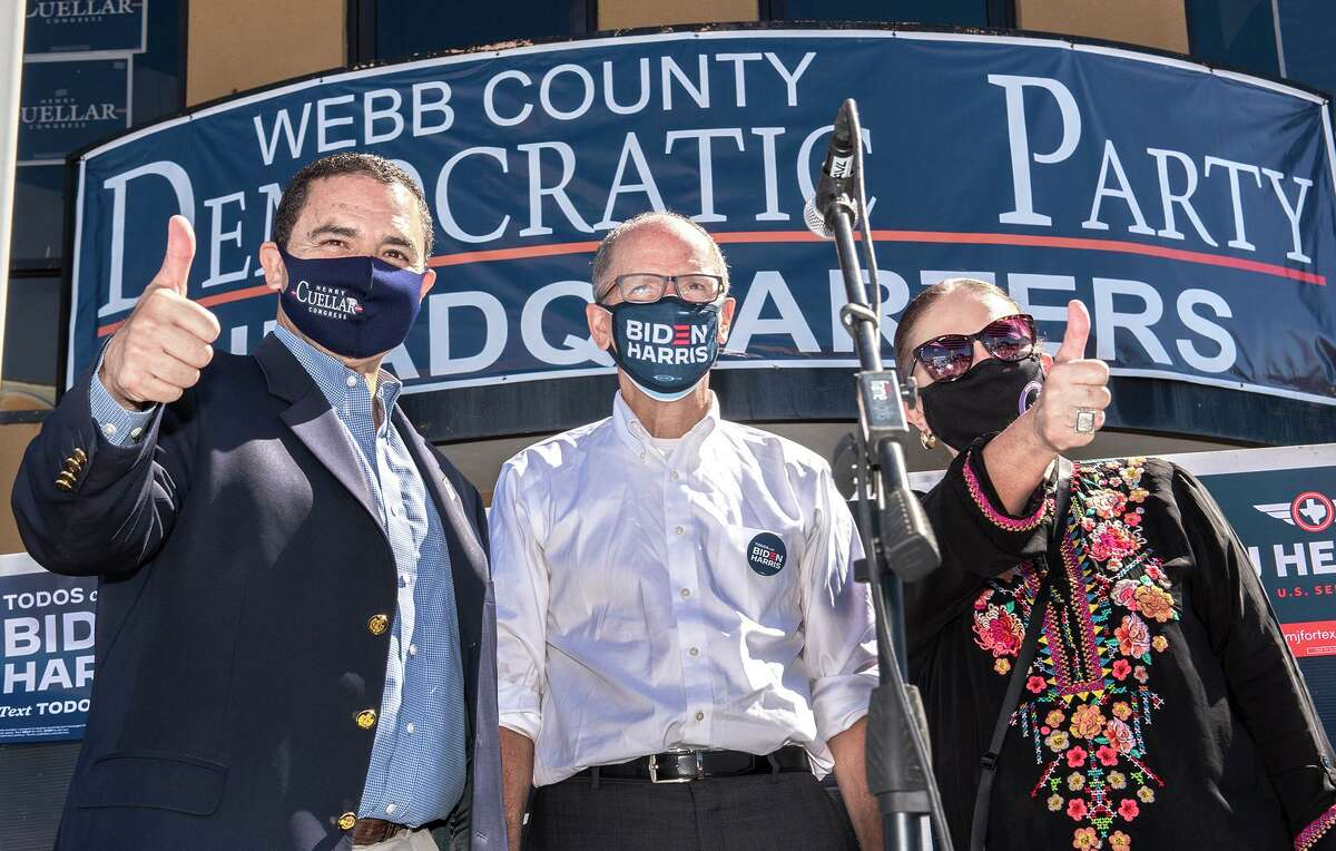 Congressman Henry Cuellar, Democratic National Committee Chair Tom Perez and Webb County Democratic Party Chair Sylvia Bruni, gather for a photo Sunday, Nov. 1, 2020, as they rally supporters at the Webb County Democratic Party Headquarters.
