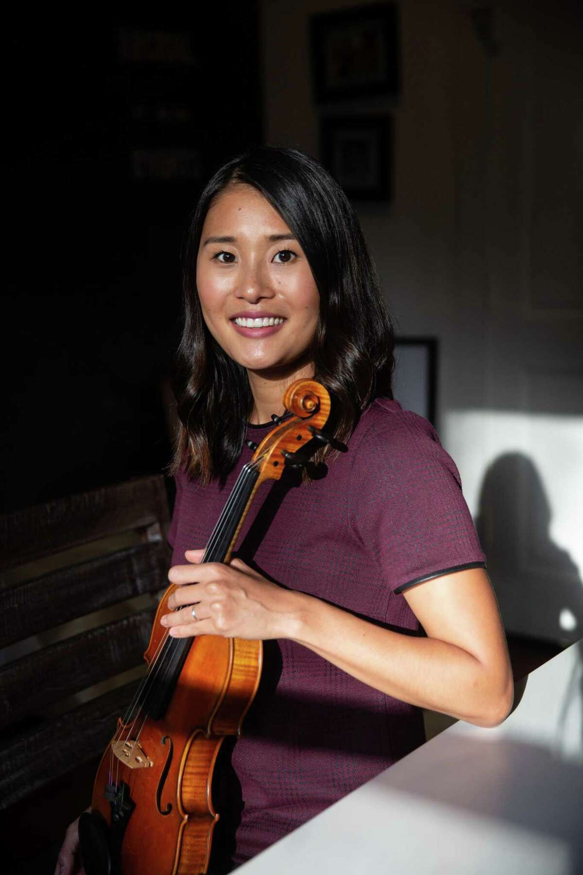 Kaori Barvin sits for a portrait in her violin studio on Oct. 14, 2020. The Heights Violin Studio is putting on a benefit concert on Nov. 8 for one of its student's father who is battling stage 4 colon cancer.