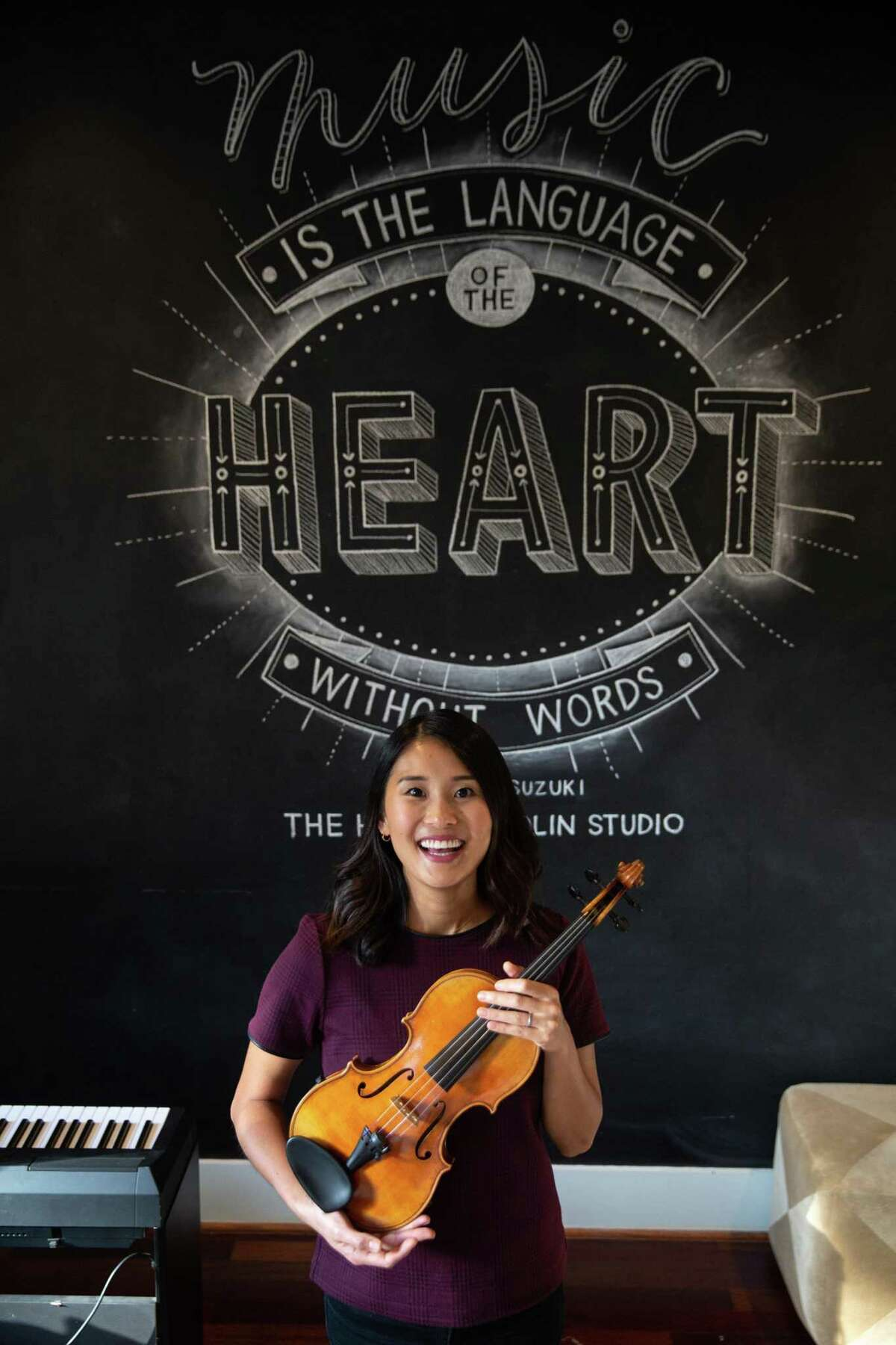 Kaori Barvin, owner of The Heights Violin Studio, poses for a portrait with her violin on Oct. 14, 2020. Barvin's violin studio is putting on a benefit concert on Nov. 8 for one of its student's father who is battling stage 4 colon cancer.