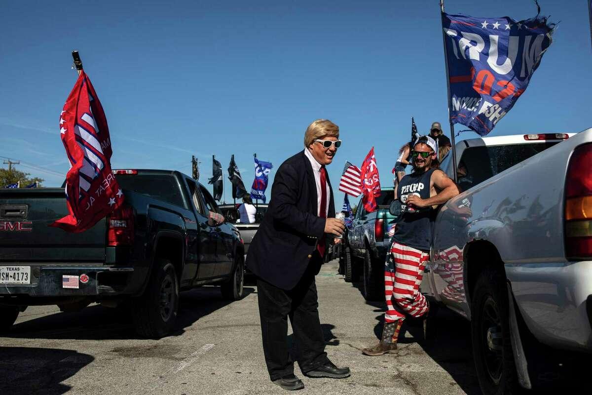 "Michael Falato, dressed as President Donald Trump, as supporters of President Donald Trump gather before driving in a ""Trump Train"" caravan in San Antonio, Nov. 1, 2020. (Tamir Kalifa/The New York Times)"