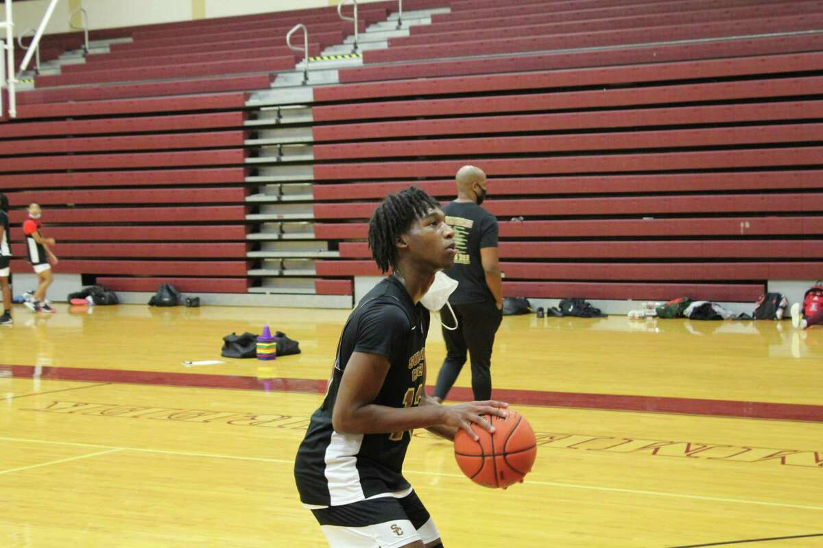 Summer Creek guard Amaree Abram getting up some shots at practice.
