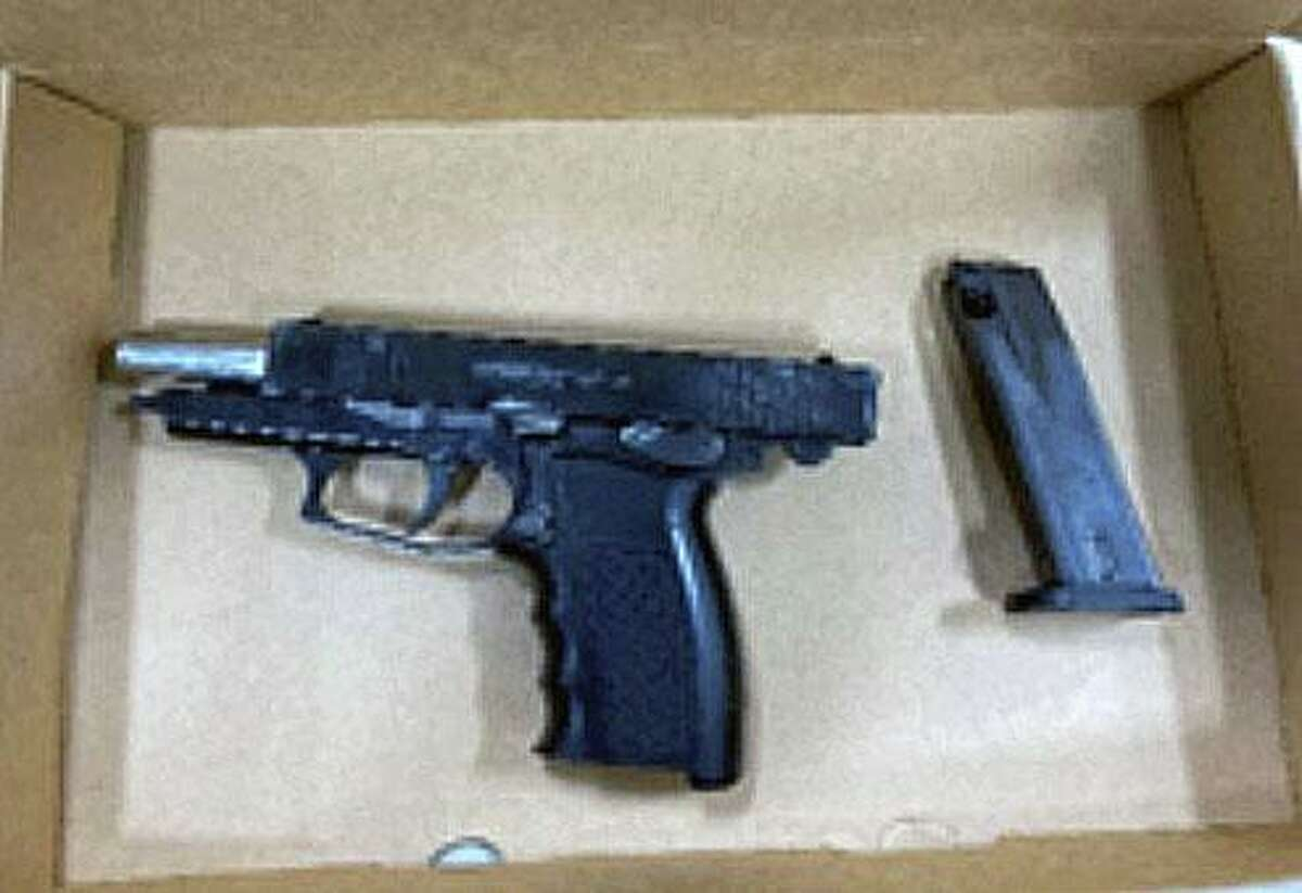 One of three guns seized by police from a Franklin Street apartment in Meriden, Conn. Police say the guns were taken during a home invasion on Sunday, Oct. 25, 2020.