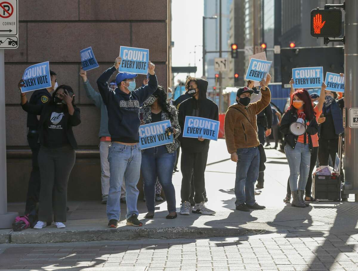 Demonstrators gather outside the Bob Casey Federal Courthouse to voice their support of the drivethrough voting which was available for early voters in Harris County, on Monday, Nov. 2, 2020, in Houston. Republicans politicians and activists filed a federal lawsuit in opposition to the voting method, which accounted for 127,000 votes.