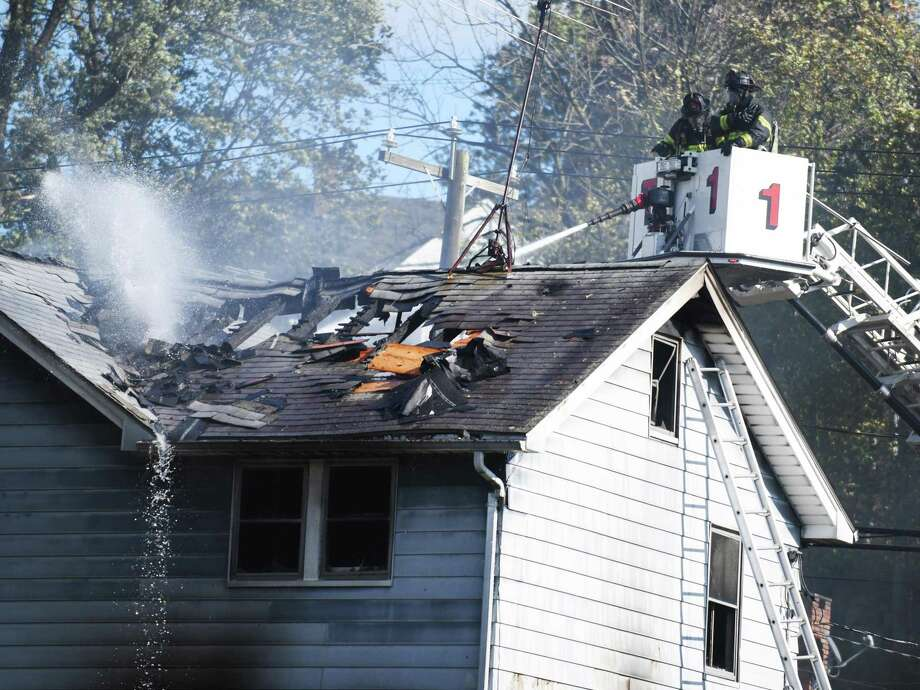 Greenwich firefighters extinguish a blaze on North Water Street in the Byram section of Greenwich, Conn. Monday, Nov. 2, 2020. Photo: Tyler Sizemore / Hearst Connecticut Media / Greenwich Time