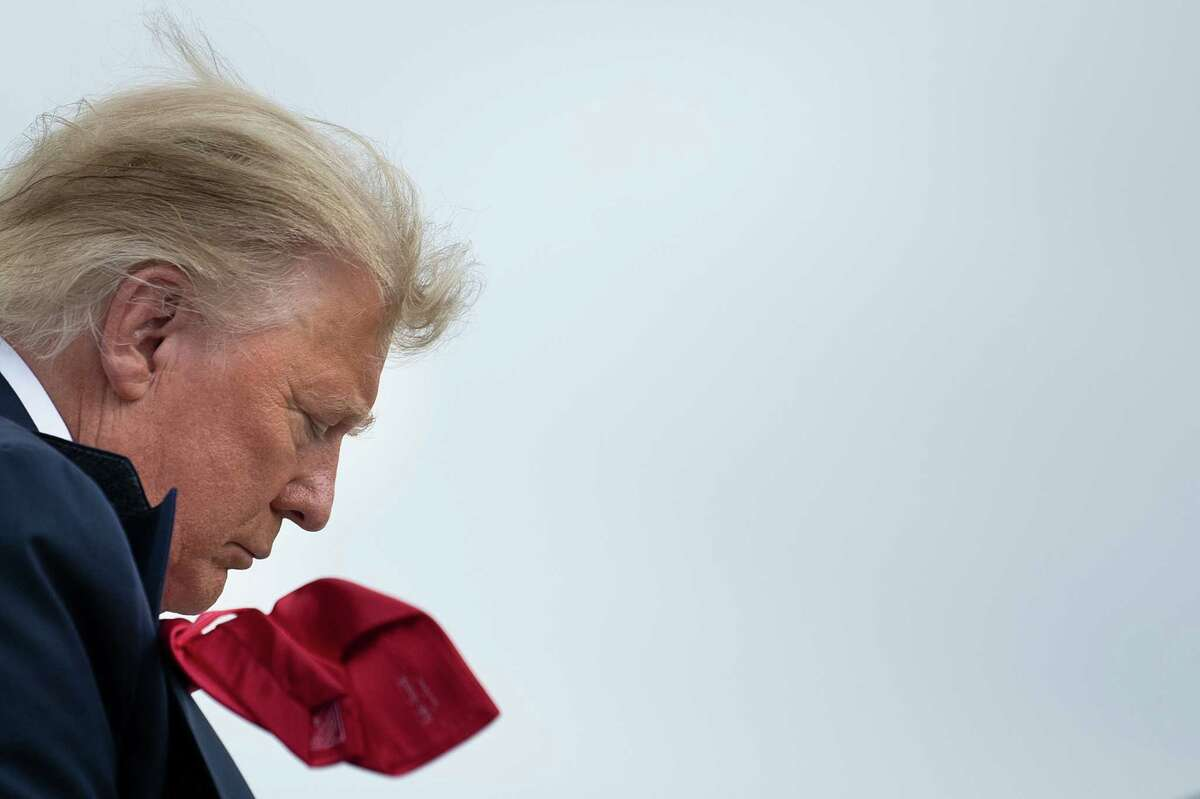US President Donald Trump boards Air Force One at Miami International Airport in Miami, Florida en route to campaign events on November 2, 2020. - The US presidential campaign enters its final day Monday with a last-minute scramble for votes by Donald Trump and Joe Biden, drawing to a close an extraordinary race that has put a pandemic-stricken country on edge. (Photo by Brendan Smialowski / AFP)