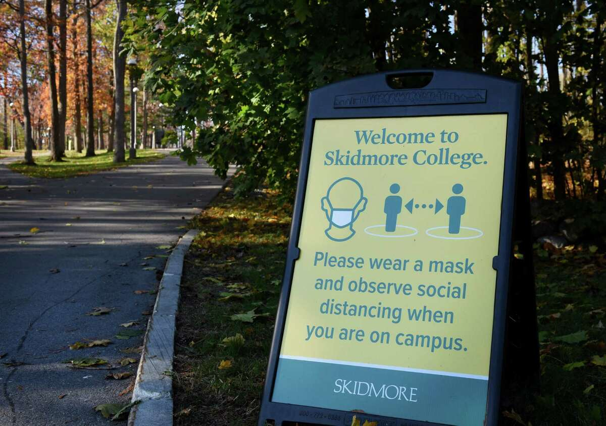 A coronavirus safety sign is posted at the North Broadway entrance to Skidmore College on Monday, Nov. 2, 2020, in Saratoga Springs, N.Y. Skidmore College suspended 46 students after they attended a party in violation of the college's COVID-19 rules. (Will Waldron/Times Union)