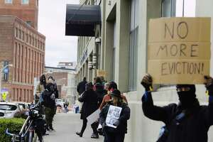 Renters and housing advocates hold a rally outside of Troy City Hall on Tuesday, Nov. 2, 2020, in Troy, N.Y. Organizers are concerned that those who have lost their jobs or are unable to work due to the pandemic will be evicted from their homes.  (Paul Buckowski/Times Union)