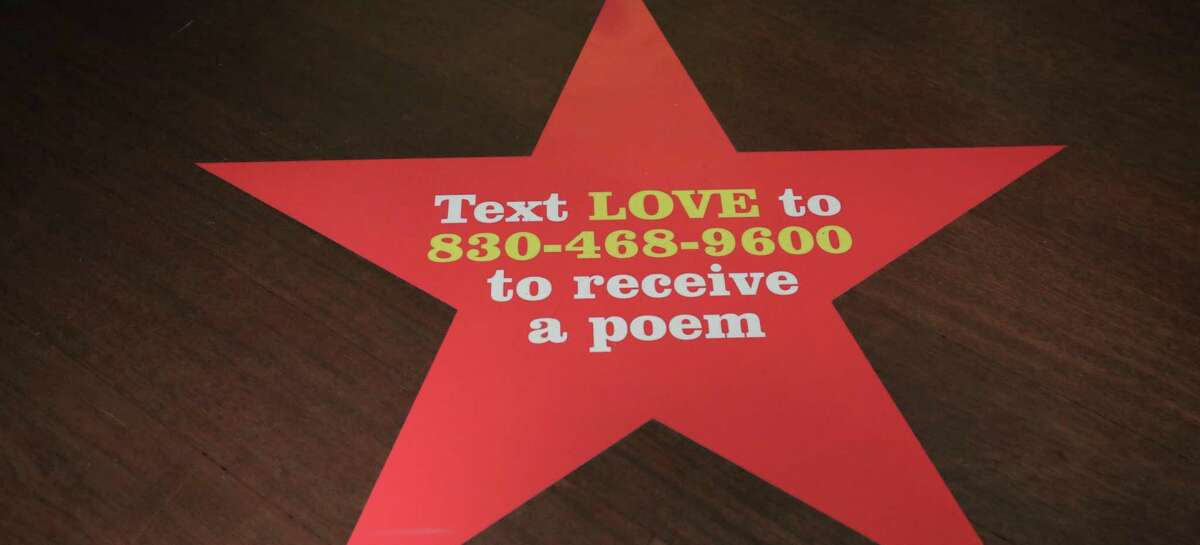 """Vinyl stickers inviting patrons to text a handful of words to a number to receive a poem by a San Antonio writer can be found throughout """"Robert Indiana: A Legacy of Love,"""" an exhibit at the McNay Art Museum."""