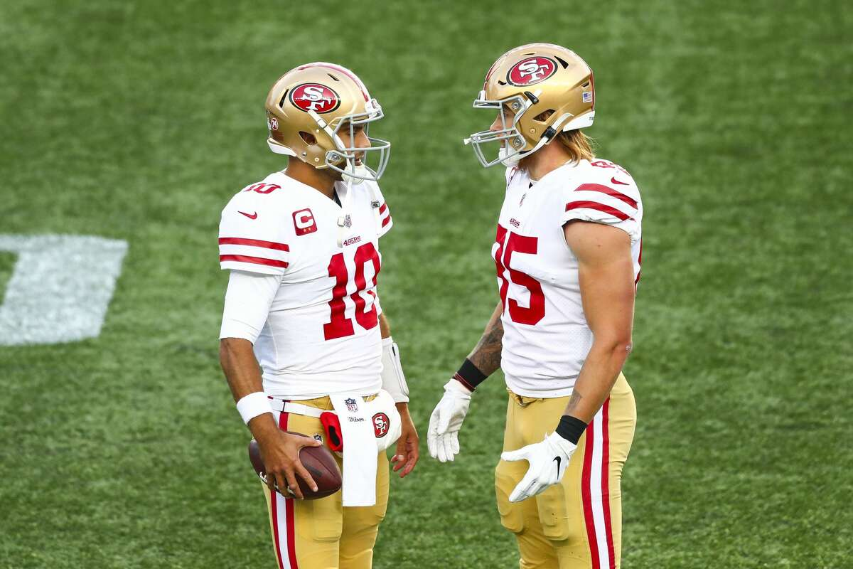 Jimmy Garoppolo, left, talks to George Kittle of the San Francisco 49ers during a game against the New England Patriots on Oct. 25, 2020, in Foxborough, Mass.